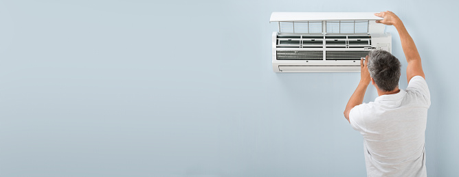 istock Man Cleaning Air Conditioning System 1199281522