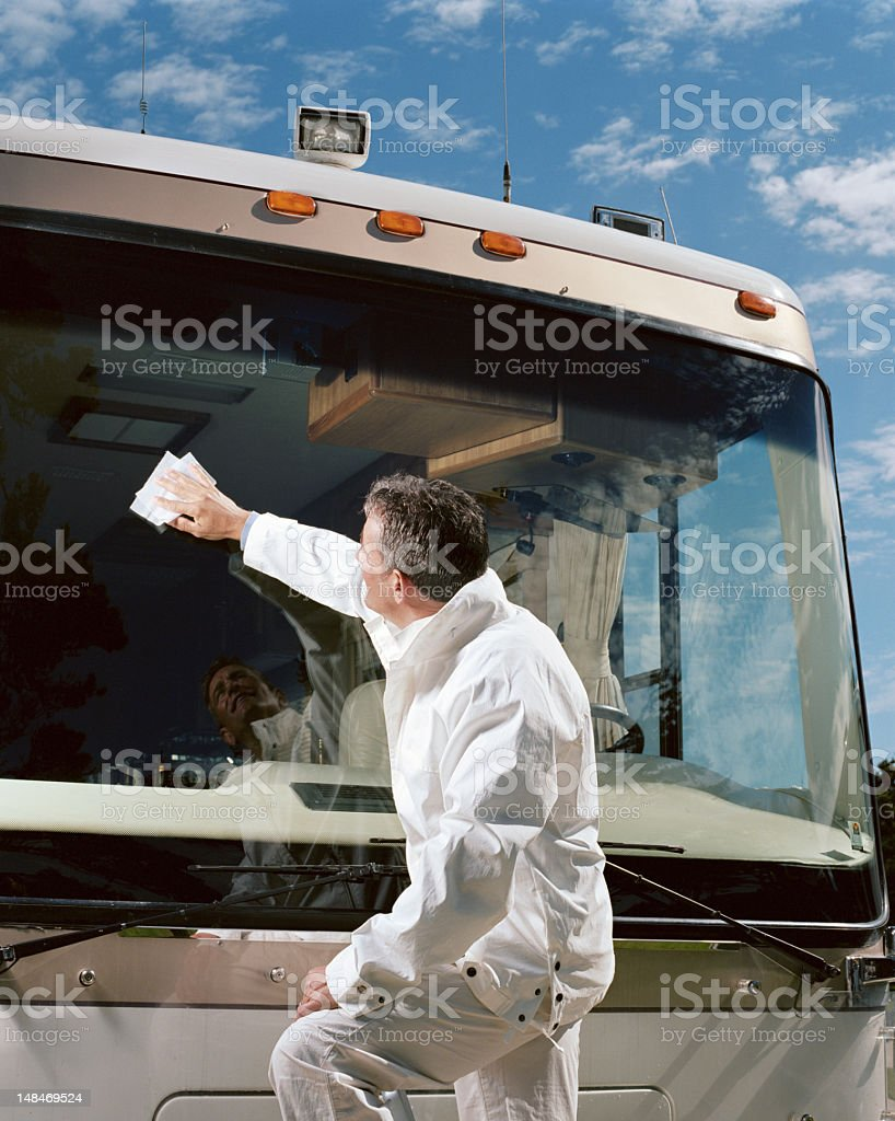 Man cleaning coach bus windshield, side view Man cleaning coach bus windshield, side view 40-44 Years Stock Photo