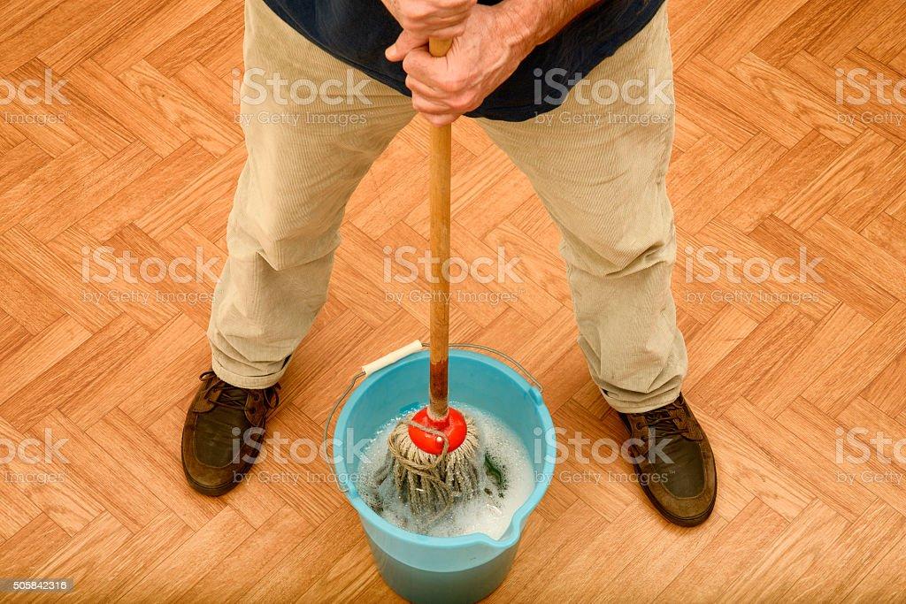 Man cleaning floor stock photo
