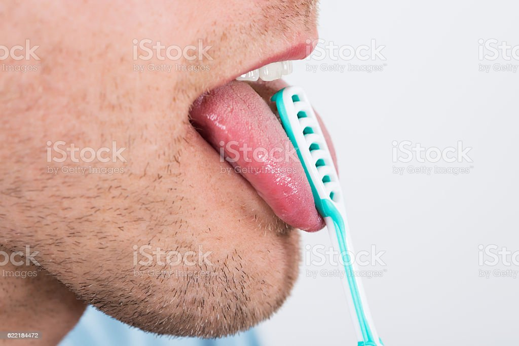 Man Cleaning Her Tongue stock photo