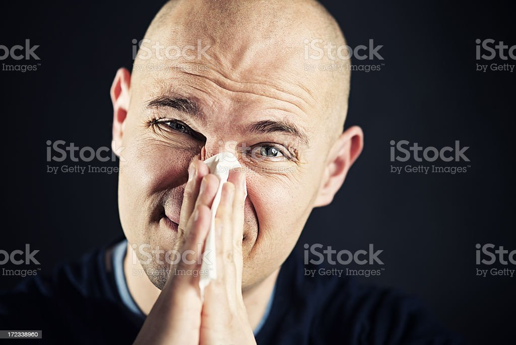Man cleaning nose royalty-free stock photo