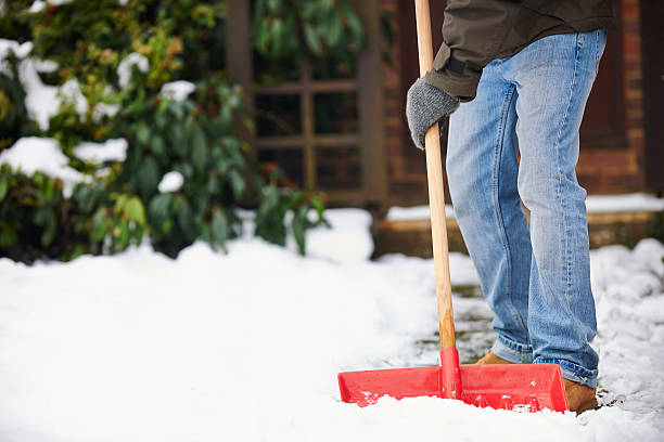 Man Clearing Snow From Path With Shovel Winter yard work glade stock pictures, royalty-free photos & images