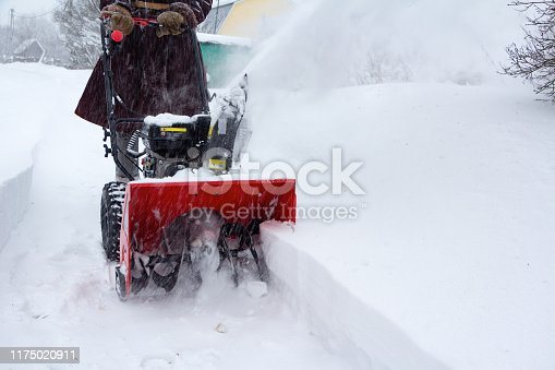 istock A man clears snow with a snow blower after a snowfall 1175020911