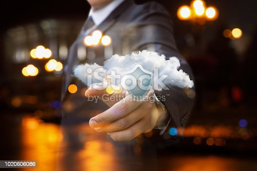 1156072209istockphoto Man clicks on a cloud with a protective shield . 1020606086
