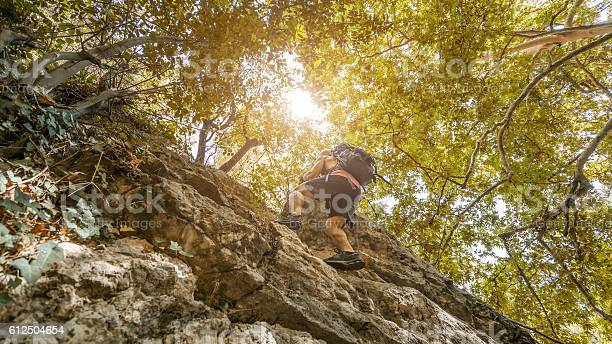 Photo of Man climb on mountain hill