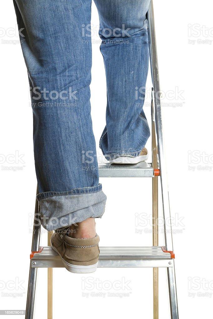 man climbing a ladder royalty-free stock photo