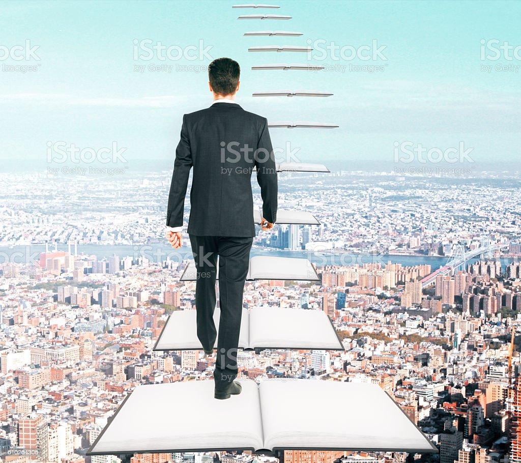 Man climbing book ladder - foto de acervo