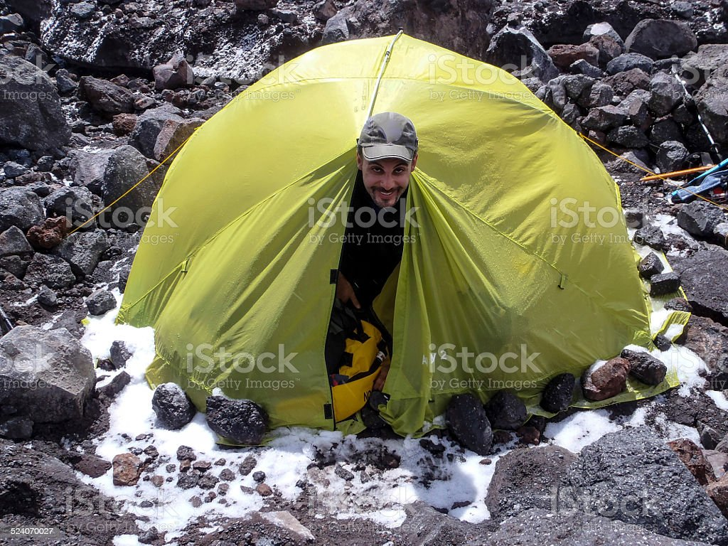 Man climbing Elbrus in Russia stock photo
