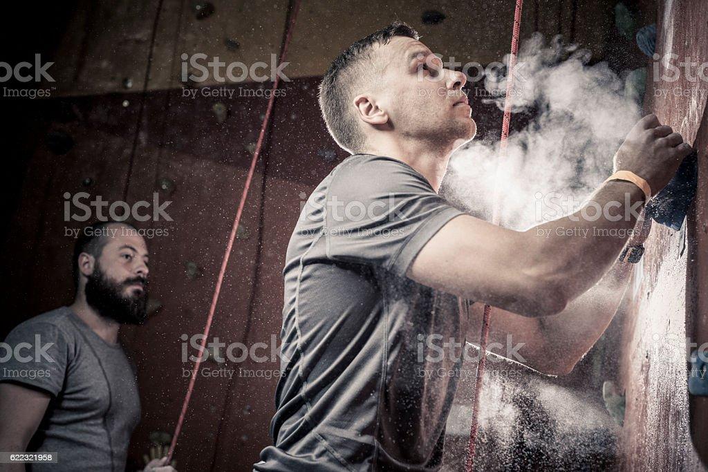 man climbing on a climbing gym. – Foto