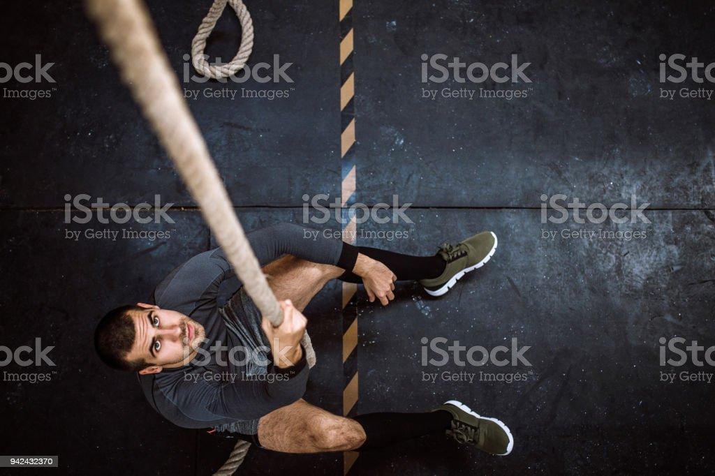 Man Climbing Rope stock photo