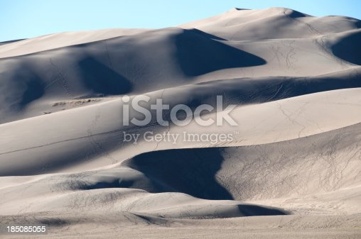 Man climbing to summit of Great Sand Dunes National Monument in Colorado