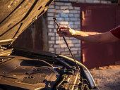 istock man close the car hood after repairing it 969483298