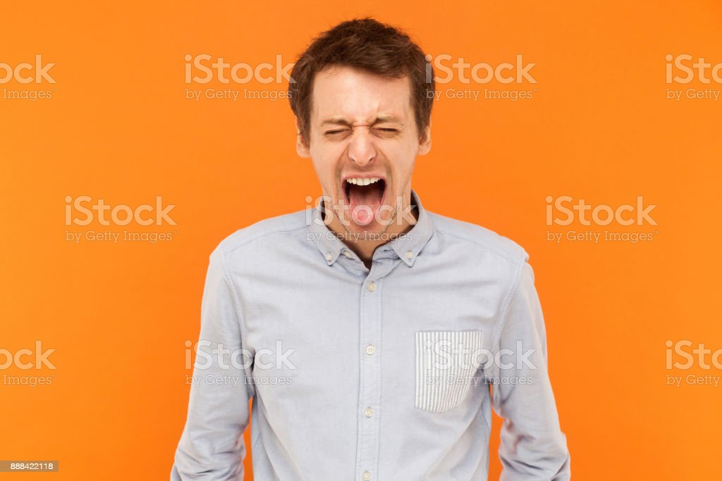 Man closed eyes and tongue out stock photo