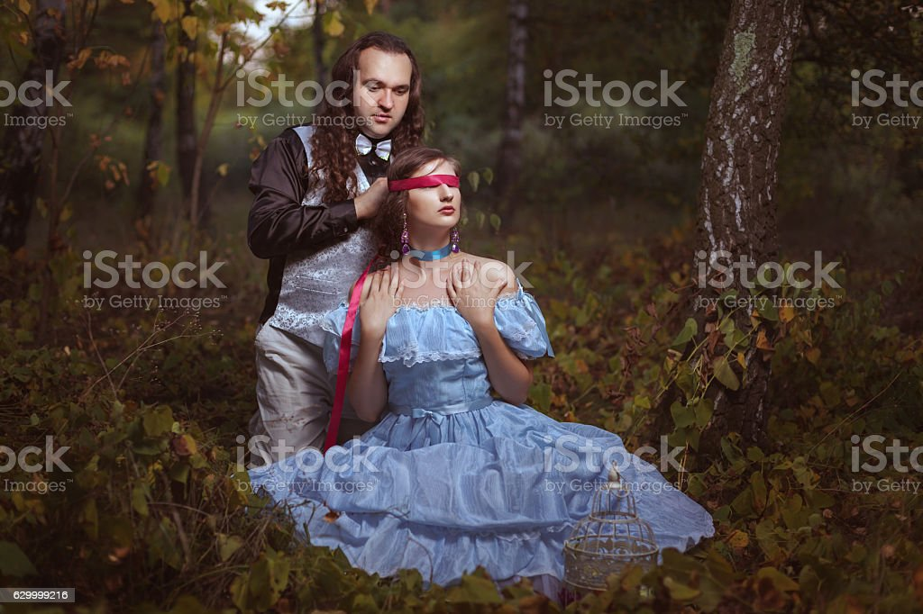 Man closed eyes to the woman. stock photo