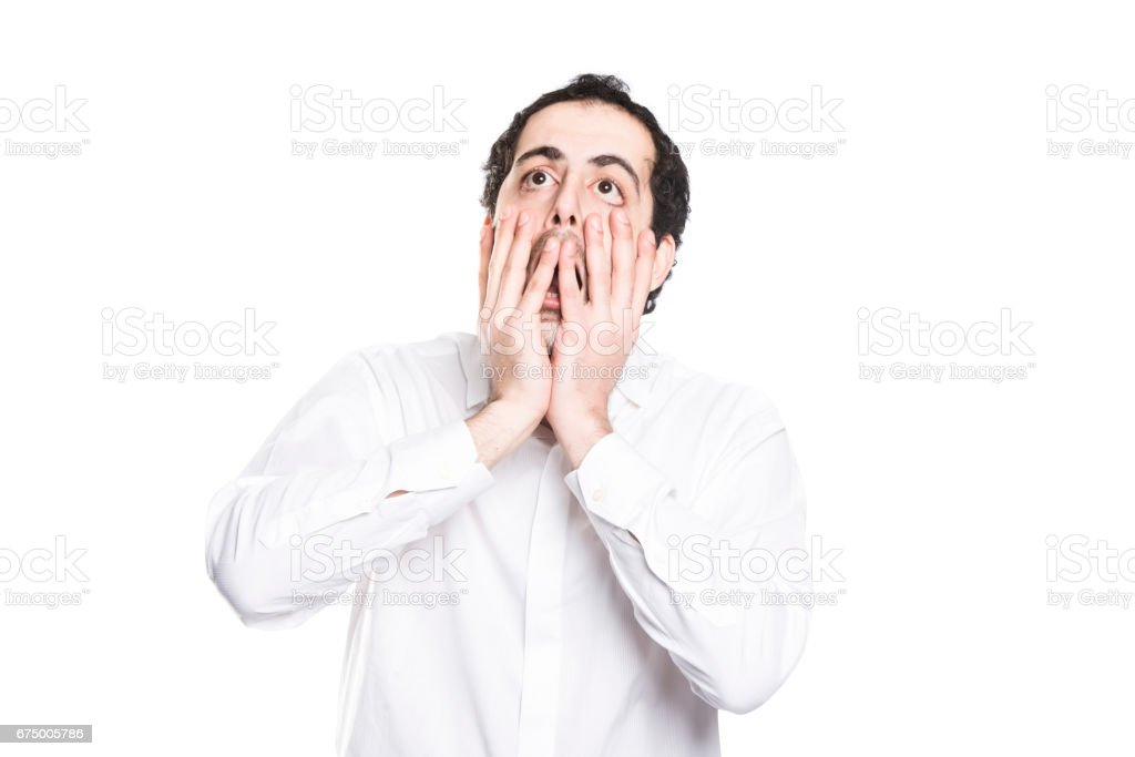 A man closing his mouth with his big hands stock photo