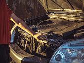 istock man closing the car hood after fixing the motor 969483288