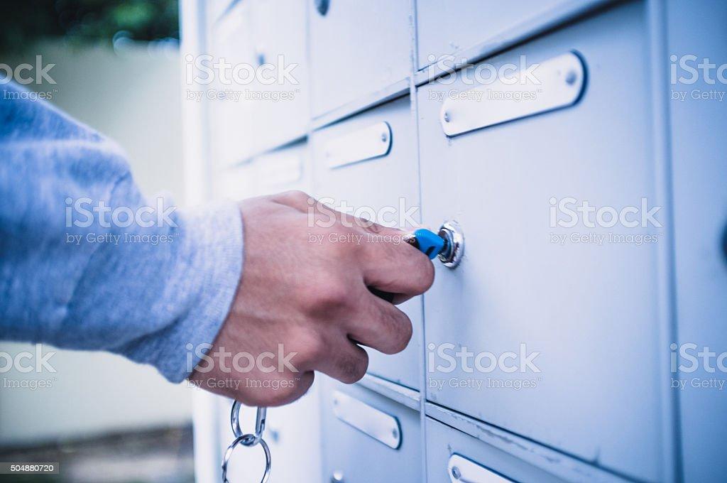 Man Closing the Post Box stock photo