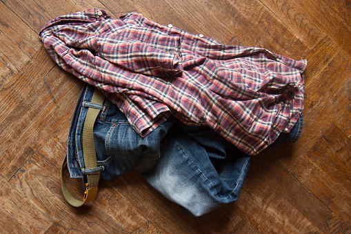 man clothes thrown on wooden floor