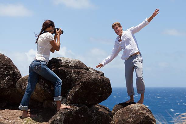 man clowns around while woman takes his photo - carolinemaryan stock pictures, royalty-free photos & images