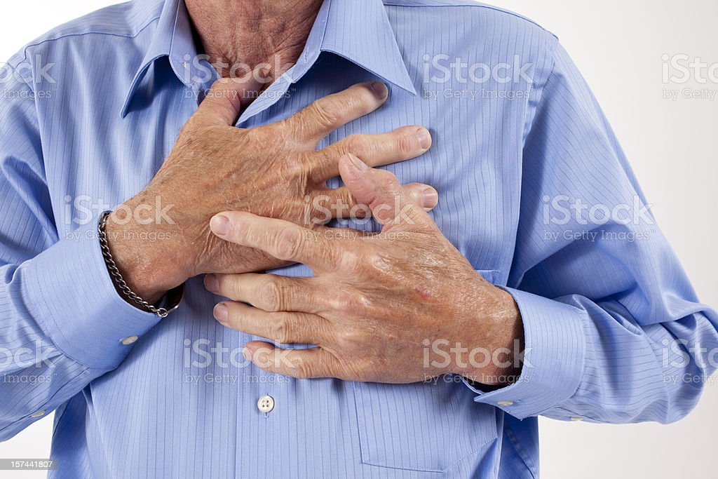 Man clutching his chest. Pain, possible heart attack. Senior adult. stock photo