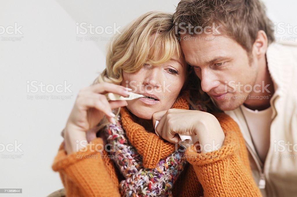 Man comforting an ill woman royalty-free stock photo