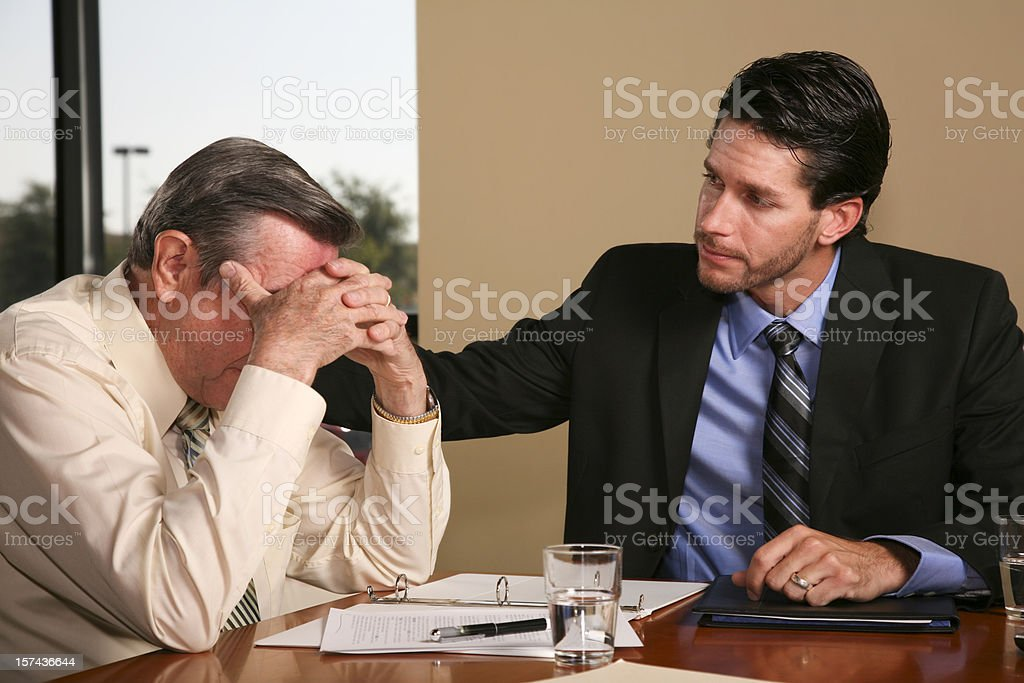 Man Comforting His Client or Co-Worker royalty-free stock photo