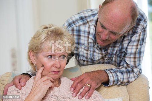 874789476istockphoto Man Comforting Senior Woman With Depression 496489068