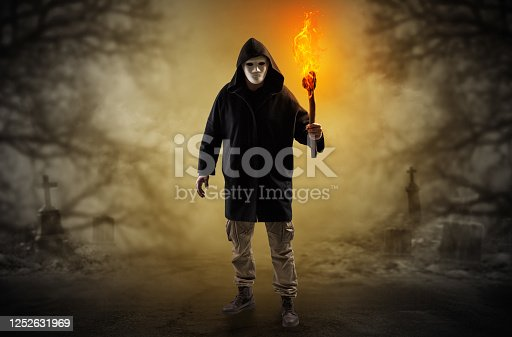 istock Man coming out from a thicket with burning flambeau 1252631969