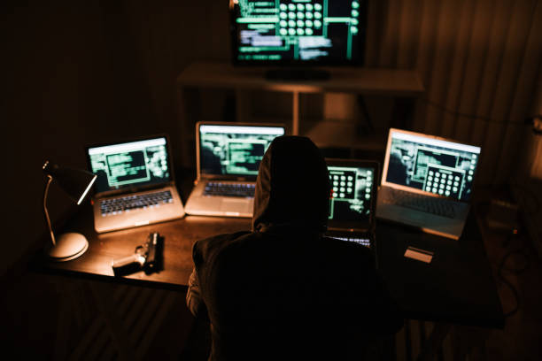 Man committing crime and stealing online information stock photo