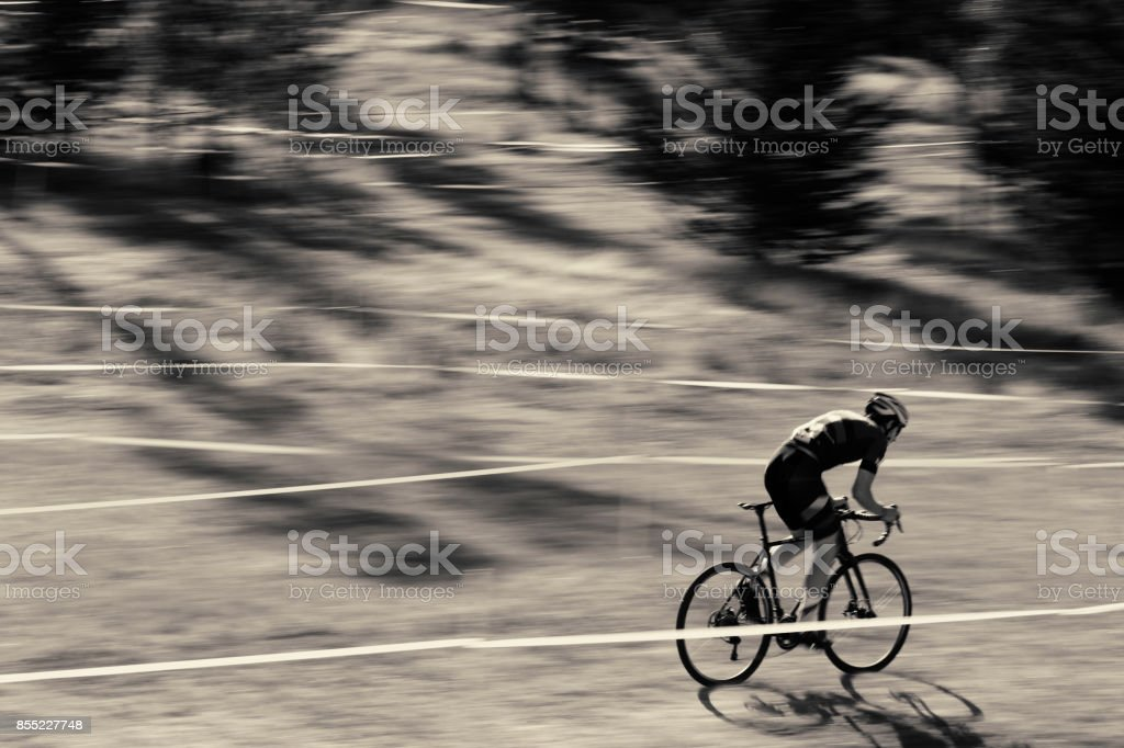 A man competes in a cyclo-cross bicycle race. stock photo