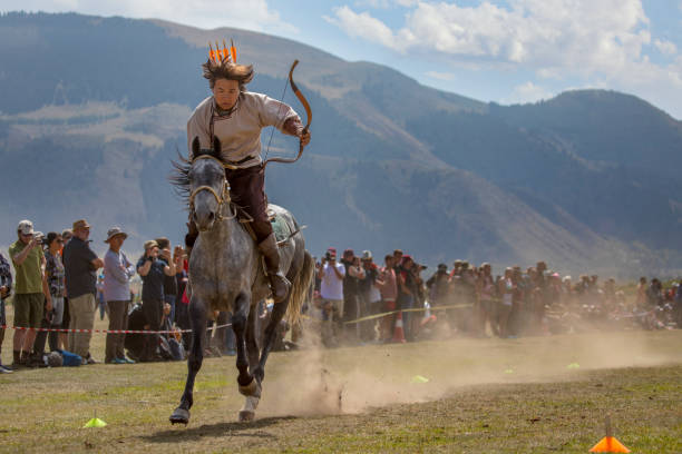 man competing at archery on horseback at World Nomad Games stock photo