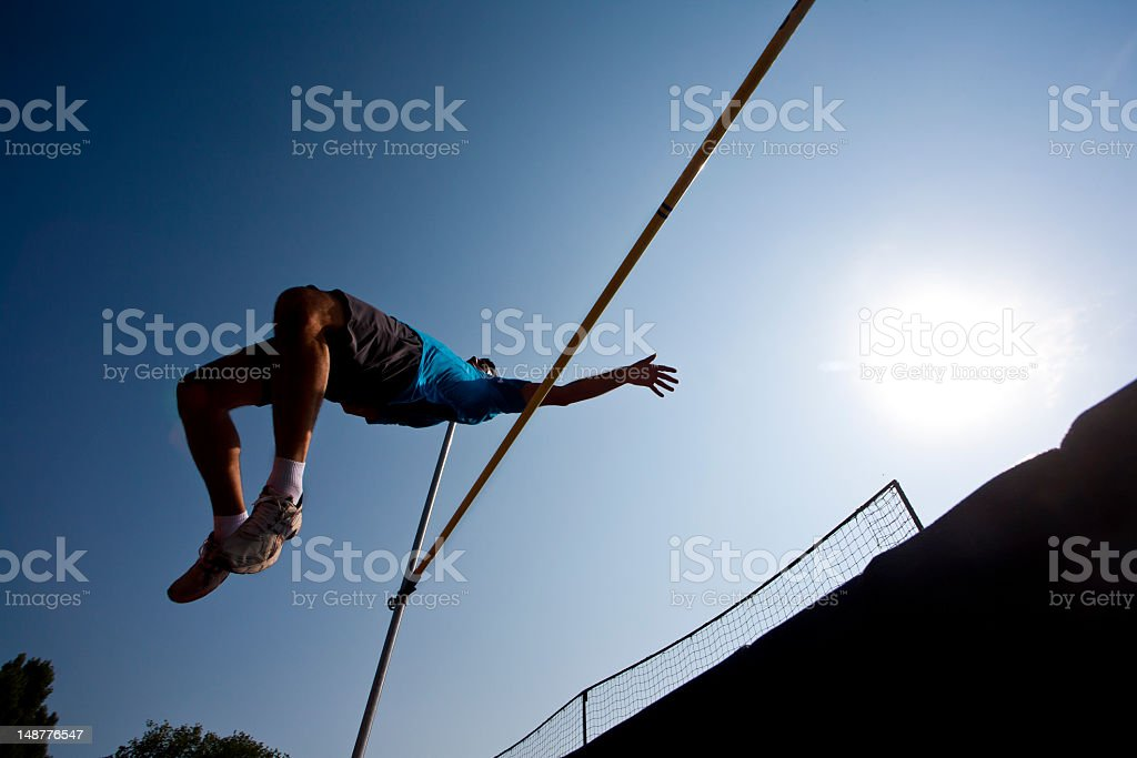 Man competing in high jump royalty-free stock photo