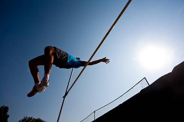 Man competing in high jump stock photo
