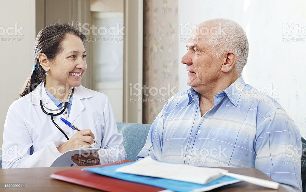 man  complaining to  doctor about feels royalty-free stock photo
