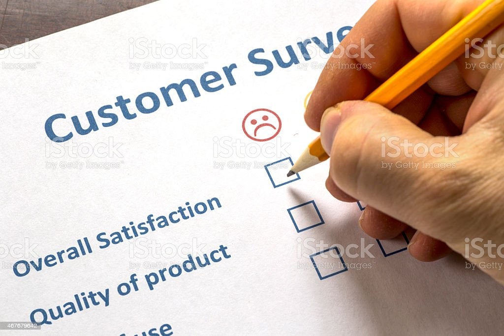 Man completing a customer survey stock photo