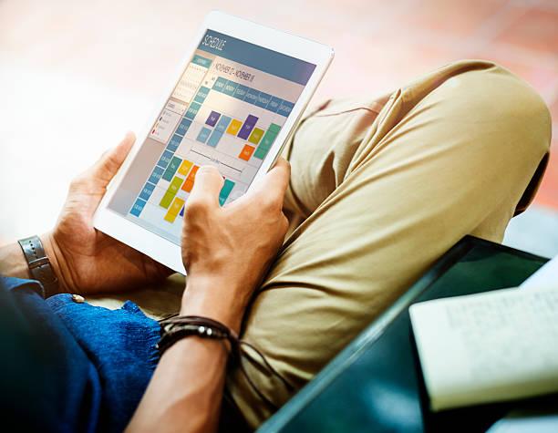 Man Conenction Tablet Schedule Planner Concept stock photo