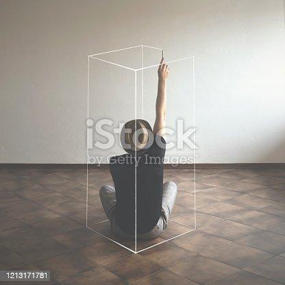 space restriction surreal concept, man delimit edges drawing fictional box around him