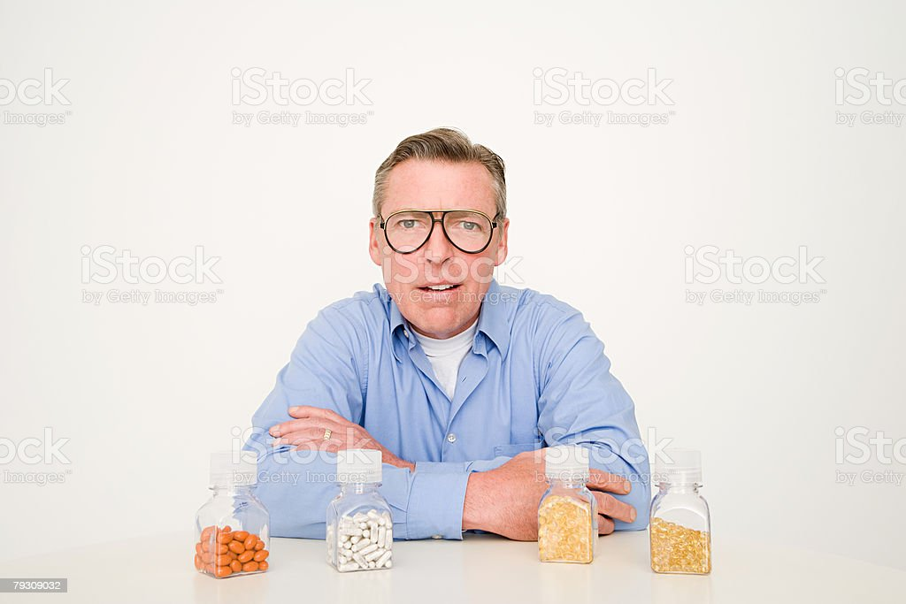 A man confused about tablets royalty-free stock photo
