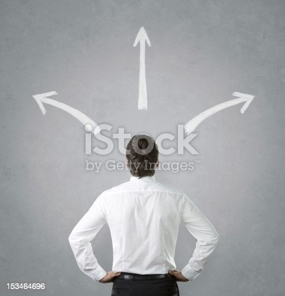 istock Man confused by white arrows pointing everywhere 153464696