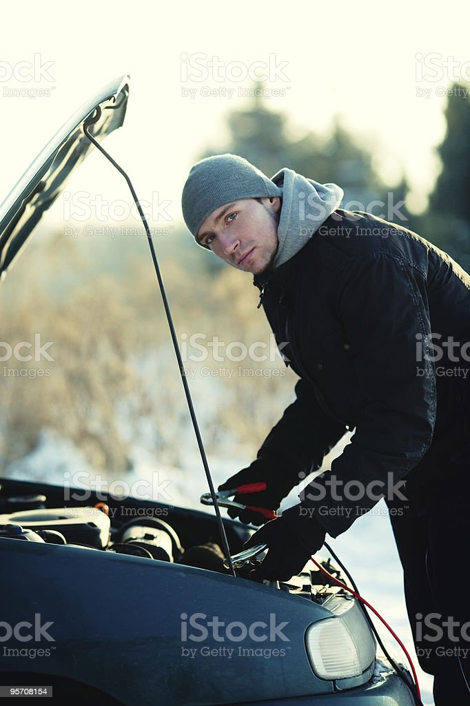 Man connecting jumper cable to battery royalty-free stock photo