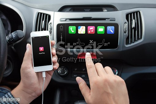 istock man connecting phone to the car media system 521707170