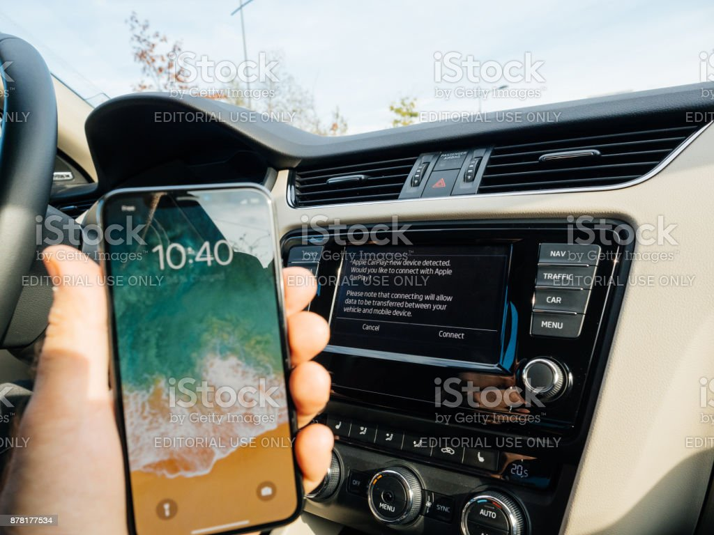 Man Connecting to Apple cArPlay the new iphone X 10 by Apple stock photo