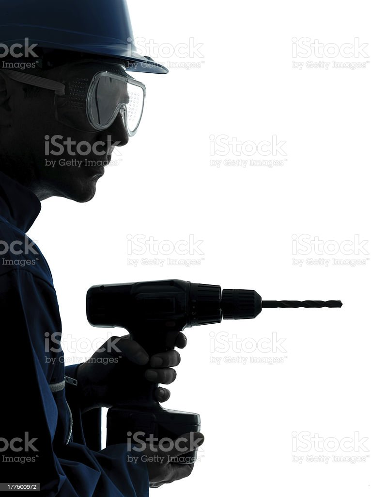 man construction worker holding drill silhouette royalty-free stock photo