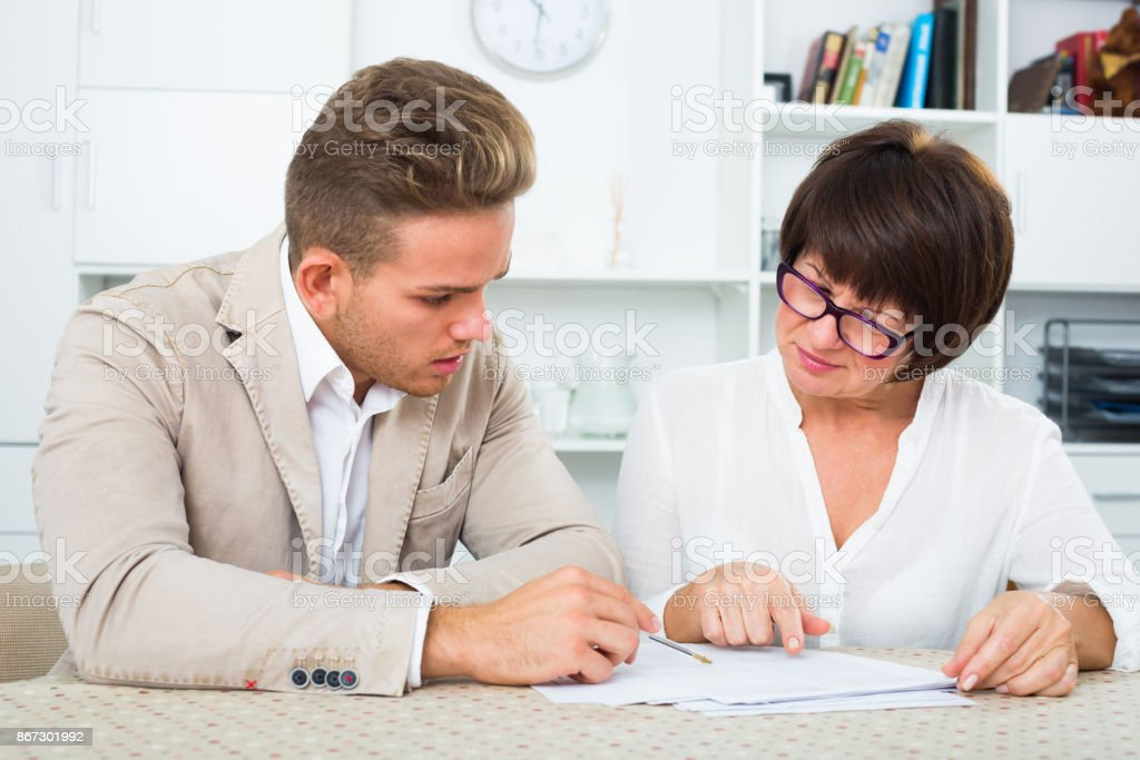 Man consults at the familiar mature lawyer stock photo