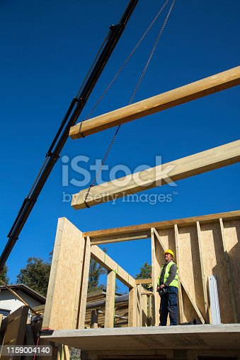 istock Man controling the crane on construction site 1159004140