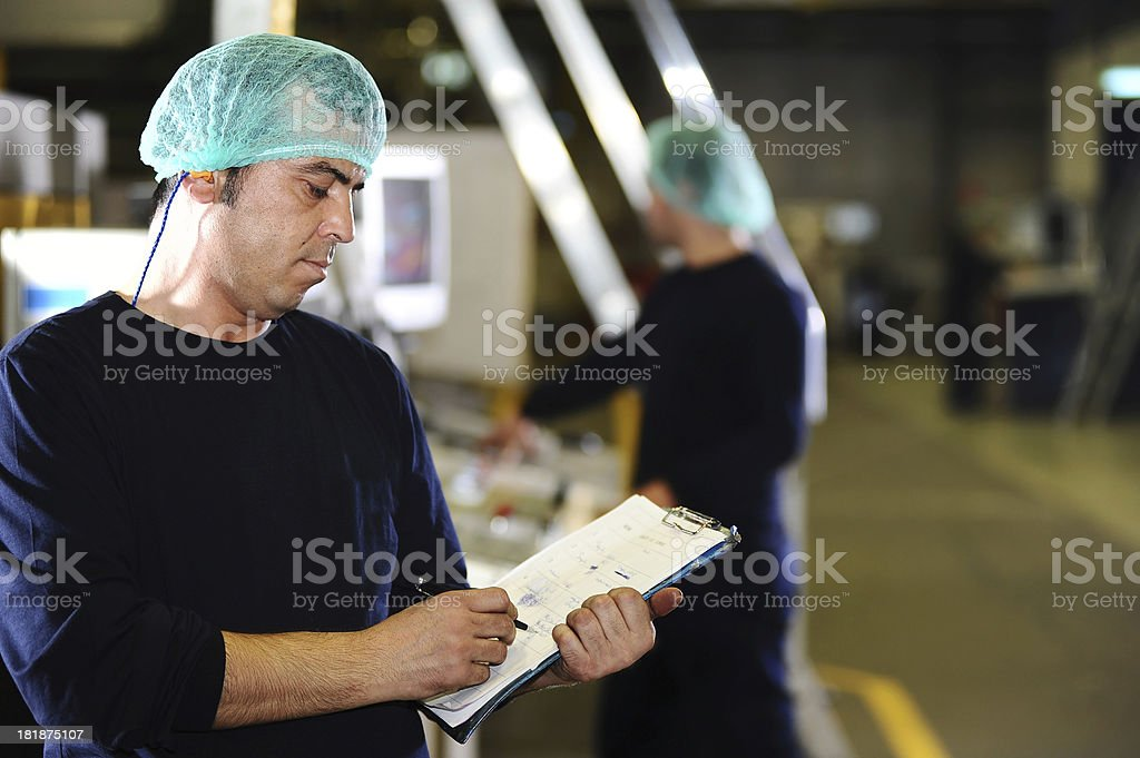 Man controlling factory workers royalty-free stock photo