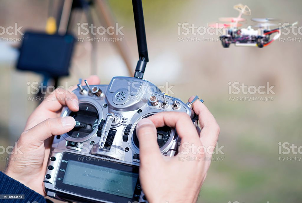 Man controls the flying drones stock photo