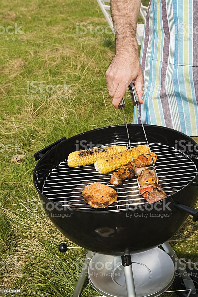 Man cooking a barbecue royalty-free stock photo