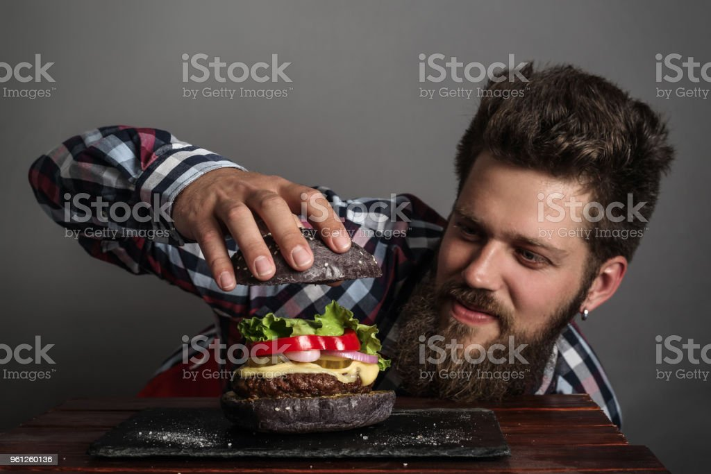 Man cooking burger stock photo