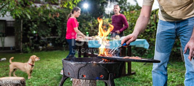 istock Man Cooking Meat On Barbecue 610774852